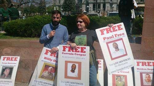 Cheri Sicard protesting for marijuana prisoners serving life sentences