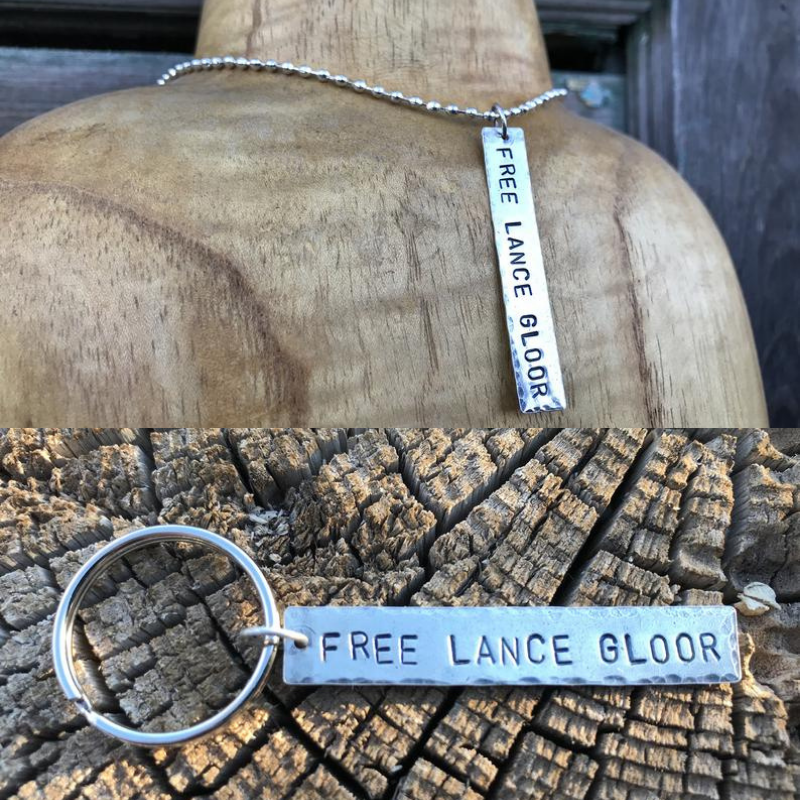 Keychain and necklace charms in nickel silver, benefitting Lance Gloor , one of 4 marijuana prisoners