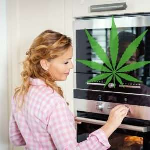 WOman turning on the oven to cook with cannabis